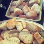 Fresh Crusty Bread And Floured Rolls